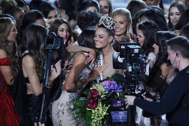 Contestants congratulate new Miss Universe Demi-Leigh Nel-Peters at the Miss Universe pageant Sunday, Nov. 26, 2017, in Las Vegas. (AP Photo/John Locher)