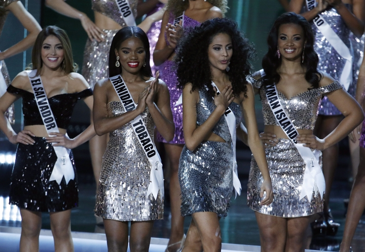 Miss Brazil Monalysa Alcantara, second from right, reacts after she was announced as a finalist at the Miss Universe pageant Sunday, Nov. 26, 2017, in Las Vegas. (AP Photo/John Locher)