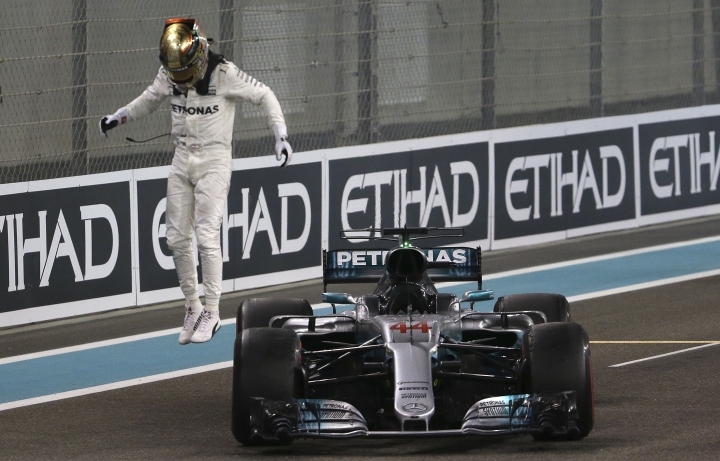 Mercedes driver Lewis Hamilton of Britain celebrates after the Emirates Formula One Grand Prix at the Yas Marina racetrack in Abu Dhabi, United Arab Emirates, Sunday, Nov. 26, 2017. (AP Photo/Luca Bruno)
