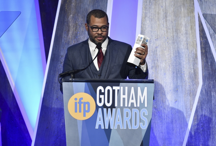 "Director Jordan Peele accepts the Bingham Ray Breakthrough director award for ""Get Out"" at the 27th annual Independent Film Project's Gotham Awards at Cipriani Wall Street on Monday, Nov. 27, 2017, in New York. (Photo by Evan Agostini/Invision/AP)"