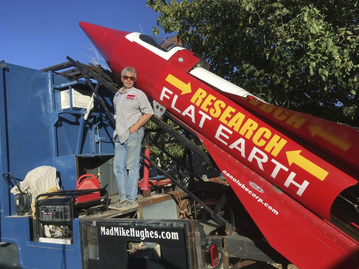 """FILE - In this Wednesday, Nov. 15, 2017, photo provided by Mike Hughes, daredevil/limousine driver Mad Mike Hughes is shown with his steam-powered vessel in Apple Valley, Cal. After going through red tape that got his original launch date scrubbed, self-taught rocket scientist """"Mad"""" Mike Hughes now plans to fly his steam-powered vessel on Monday, Dec. 4, 2017. That is, if he can get the green light from the Bureau of Land Management. (Waldo Stakes/Courtesy of Mad Mike Hughes via AP)"""