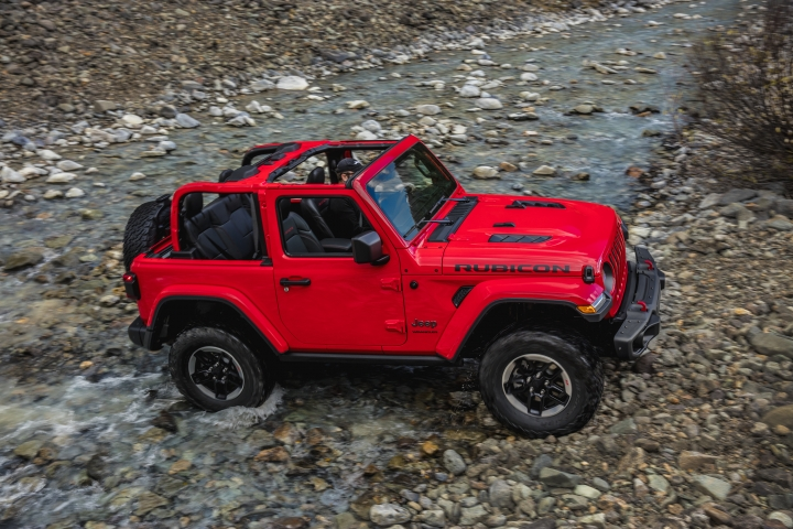 This photo provided by Fiat Chrysler Automobiles shows the 2018 Jeep Wrangler Rubicon. When Fiat Chrysler engineers and designers set out to revamp the venerable Jeep Wrangler for the first time in a decade, they didn't want to mess much with its looks. But beneath the similar appearance of the 2018 version being unveiled Wednesday, Nov. 29, 2017, at the Los Angeles Auto Show, a lot is different. (Fiat Chrysler Automobiles via AP)