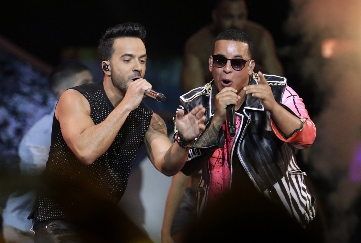 """FILE - In this April 27, 2017, file photo, singers Luis Fonsi, left, and Daddy Yankee perform during the Latin Billboard Awards in Coral Gables, Fla. Despacito,"""" Fonsi's mega-hit with Daddy Yankee, is nominated for several Grammy Awards including record of the year, song of the year and best pop duo/group performance. The 60th Annual Grammy Awards will air on CBS, Sunday, Jan. 28, 2018 in New York. (AP Photo/Lynne Sladky, File)"""