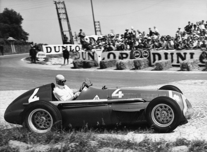"FILE - In this July 1, 1951 file photo Juan Manuel Fangio comes out of a bend at speed during the race, driving a supercharged 1.5 Liter Alfa Romeo during the Grand Prix D'Europe at Rheims, France. Alfa Romeo has joined up with the Sauber team for a return to Formula One after an absence of more than 30 years. Sauber announced Wednesday, Nov. 29, 2017 that it has reached a ""multi-year technical and commercial partnership"" with the Italian automaker, which is part of Fiat Chrysler Automobiles (FCA). From 2018, the team will be known as the Alfa Romeo Sauber F1 Team. "" (AP Photo/File)"