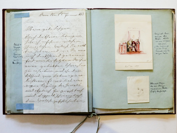 In this Nov. 28, 2017 photo, a letter and drawings are fixed in a scrapbook with items belonging to Britain's former Queen Victoria in Berlin, Germany. The scrapbook is displayed at Grisebach auctioneers and will be offered at an auction in Berlin on Thursday, Nov. 30, 2017. (AP Photo/Markus Schreiber)