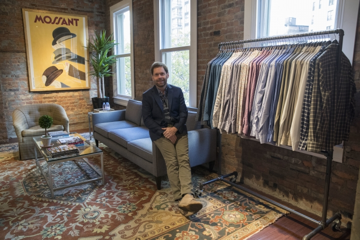 In this Tuesday, Nov. 21, 2017, photo, Jeff Hansen, CEO of Peter Manning, poses for a photo in the store's showroom in New York. The clothing retailer for men 5 feet 8 inches tall or under, tries to convey to shoppers that it offers quality at a fair price. (AP Photo/Mary Altaffer)