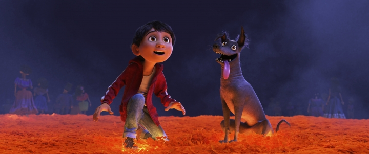 """This image released by Disney-Pixar shows characters Miguel, voiced by Anthony Gonzalez, left, and Dante in a scene from the animated film, """"Coco,"""" one of the largest U.S. productions ever to feature an almost entirely Latino cast. The film is drawing large audiences among Latinos and offering a momentary relief to some anxious about uncertain immigration policies. (Disney-Pixar via AP)"""