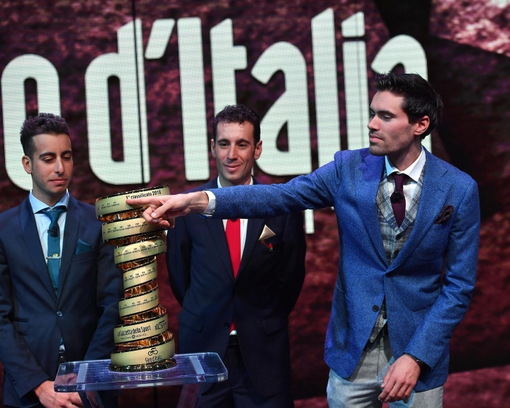 "Left to right, Italian riders Fabio Aru and Vincenzo Nibali and Dutch rider Tom Dumoulin pose for a photo near the trophy during the presentation of the ""Giro d'Italia"", Tour of Italy, 2018 in Milan, Italy, Wednesday, Nov. 29, 2017. Four-time Tour de France champion Chris Froome says he will ride the Giro d'Italia next year in an attempt to win a third consecutive Grand Tour. (Daniel Dal Zennaro/ANSA via AP)"