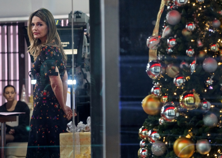 """""""Today"""" show host Savannah Guthrie looks out the window while on the set of the show Wednesday, Nov. 29, 2017, in New York, after NBC News fired host Matt Lauer. NBC News announced Wednesday, Nov. 29, 2017, that Lauer was fired for """"inappropriate sexual behavior."""" (AP Photo/Craig Ruttle)"""