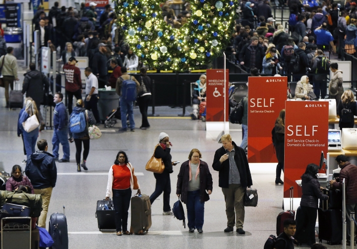 FILE - In this Wednesday, Nov. 22, 2017, file photo, passengers pass through Terminal A at Logan International Airport in Boston. It's getting late for booking holiday travel, but not too late. Experts say there are tips for procrastinators to find affordable airfares and hotel rooms. Flexibility is the key. (AP Photo/Michael Dwyer, File)