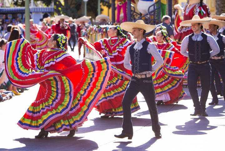This undated photo provided by Disneyland shows performers at the Festival of Holidays at Disney California Adventure park in Anaheim, Calif. The festival celebrates holidays from a variety of cultures, including Three Kings Day, Hanukkah and Kwanzaa, with music, dance, food and craft-making through Jan. 7. (Scott Brinegar/Disneyland Resort via AP)