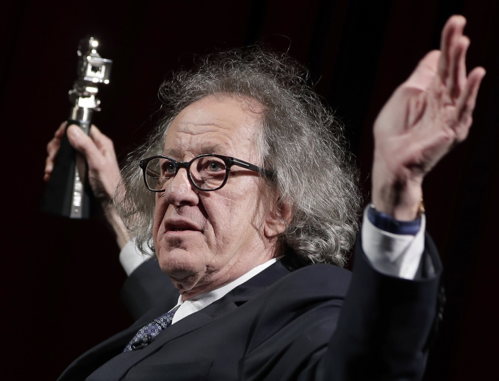 "FILE - In this Feb. 11, 2017 file photo, Australian actor Geoffrey Rush poses with his 'Berlinale Camera Award' wich he received prior to the screening of the film 'Final Portrait' at the 2017 Berlinale Film Festival in Berlin, Germany. The Sydney Theatre Company says it received a complaint of ""inappropriate behavior"" against Rush, an allegation lawyers for the Oscar winner denied. The company wasn't disclosing details of the behavior alleged to have occurred while the 66-year-old Australian actor was an employee. Media reports say the allegation dated from the theater's production of ""King Lear,"" about two years ago. His lawyers deny Rush was involved in inappropriate behavior. (AP Photo/Michael Sohn, File)"