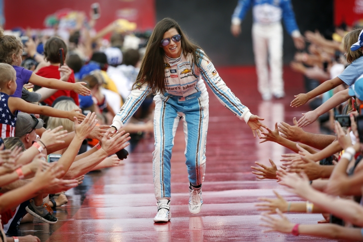 FILE - In this July 2, 2016, file photo, Danica Patrick greets fans during driver introductions before the start of the NASCAR Sprint Cup auto race at Daytona International Speedway in Daytona Beach, Fla. Patrick will race only 2 more times next season and end her career at the Indianapolis 500. It will end nearly 2 decades of racing for one of the most recognizable athletes in the world and send Patrick to a new phase of her life. (AP Photo/Wilfredo Lee, File)