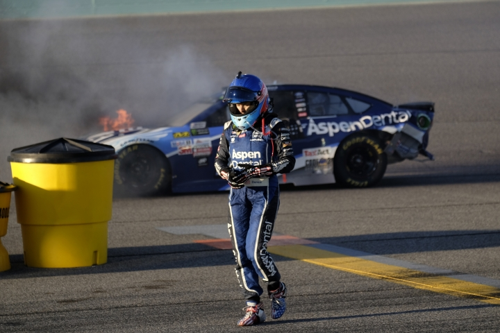 FILE - In this Sunday, Nov. 19, 2017, file photo, Danica Patrick walks away from her car as it catches fire after hitting the wall along turn two during the NASCAR Cup Series auto race at Homestead-Miami Speedway in Homestead, Fla. Patrick will race only 2 more times next season and end her career at the Indianapolis 500. It will end nearly 2 decades of racing for one of the most recognizable athletes in the world and send Patrick to a new phase of her life. (AP Photo/Gaston De Cardenas, File)