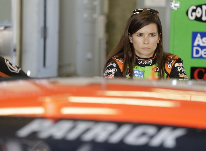 FILE - In this July 25, 2014, file photo, driver Danica Patrick waits to practice for the NASCAR Brickyard 400 Sprint Cup series auto race at the Indianapolis Motor Speedway in Indianapolis. Patrick will race only 2 more times next season and end her career at the Indianapolis 500. It will end nearly 2 decades of racing for one of the most recognizable athletes in the world and send Patrick to a new phase of her life.(AP Photo/Darron Cummings, File)