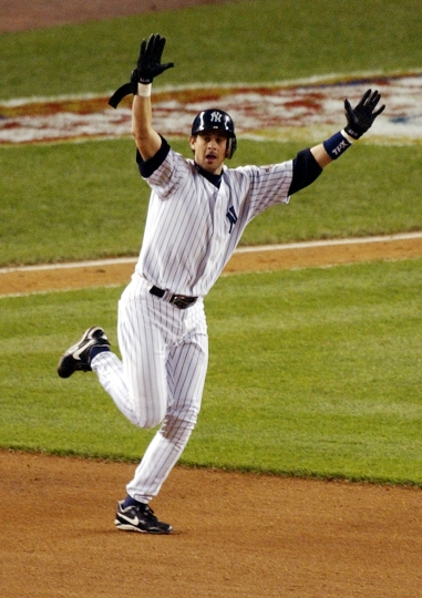 FILE - In this Oct. 16, 2003, file photo, New York Yankees' Aaron Boone celebrates his game-winning home run off Boston Red Sox pitcher Tim Wakefield during the 11th inning of Game 7 of the American League Championship Series in New York. A person familiar with the decision says the Yankees have picked ESPN broadcaster Boone to succeed Joe Girardi as manager. The person spoke on condition of anonymity Friday night, Dec. 1, 2017, because the decision had not been announced by the team. Now 44, Boone has never been a manager or even a coach at any level since retiring as a player after the 2009 season. (AP Photo/Bill Kostroun, File)