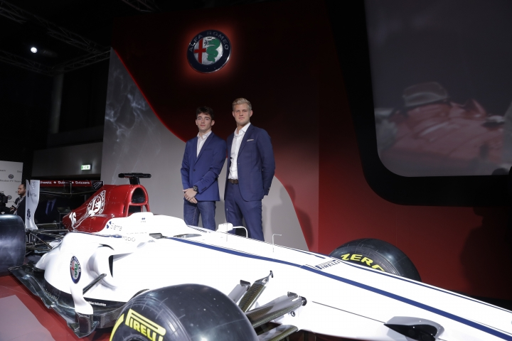 Drivers Marcus Ericsson, of Sweden, right, and Charles Leclerc, of Monaco, pose for photographers near the newly unveiled Alfa Romeo Sauber F1 Team on the occasion of its official presentation in Arese, Italy, Saturday, Dec. 2, 2017. The Alfa Romeo Sauber F1 Team will compete in the 2018 Formula 1 World Championship. (AP Photo/Luca Bruno)