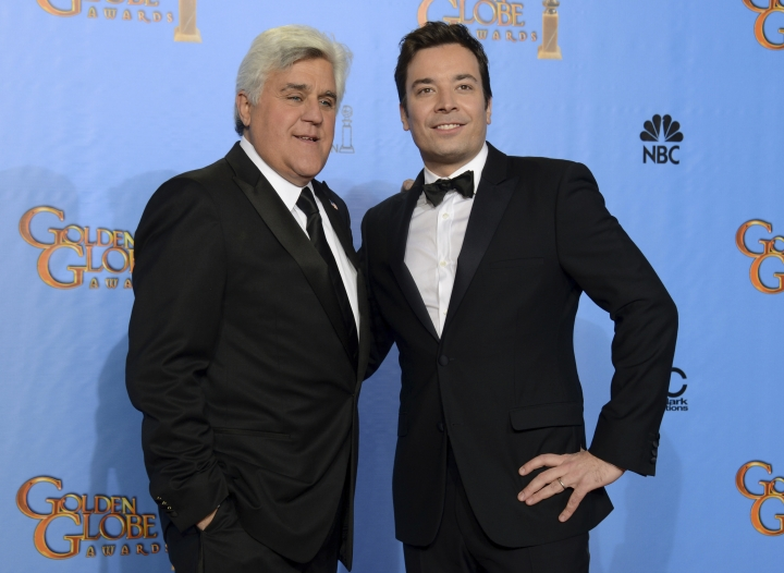 """FILE - In this Jan. 13, 2013, file photo, presenters Jimmy Fallon, left, and Jay Leno pose backstage at the 70th Annual Golden Globe Awards in Beverly Hills, Calif. There are comedy clubs across the country now, and in Budd Friedman's just-published memoir, """"The Improv: An Oral History of the Comedy Club That Revolutionized Stand-Up,"""" generations of comedians from Jay Leno to Jimmy Fallon give the author the lion's share of the credit. (Photo by Jordan Strauss/Invision/AP, File)"""