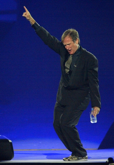 """FILE - In this Sept. 28, 2002, file photo, actor and comedian Robin Williams performs at the MGM Grand Hotel and Casino in Las Vegas. Williams, who arrived at the Improv in the mid-1970s quickly became one of Hollywood's biggest stars after he landed the TV show """"Mork & Mindy"""" in 1978. Later, he became one of the Improv's biggest benefactors, hosting a fundraiser to get its Los Angeles location reopened after it was badly damaged by a fire. (AP Photo/Eric Jamison, File)"""