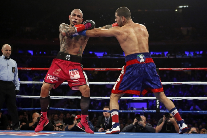 Miguel Cotto, left, of Puerto Rico, and Sadam Ali trade blows during the second round of a WBO junior middleweight title boxing match Saturday, Dec. 2, 2017, in New York. (AP Photo/Adam Hunger)