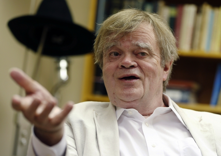 """FILE - In this July 20, 2015, file photo, Garrison Keillor, creator and host of """"A Prairie Home Companion,"""" appears during an interview in St. Paul, Minn. Chris Thile who replaced Keillor as host of """"A Prairie Home Companion"""" said Saturday, Dec. 2, 2017, that the allegations against Keillor came as """"heartbreaking news."""" (AP Photo/Jim Mone, File)"""