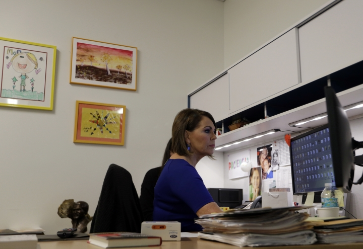 In this Wednesday, Nov. 29, 2017 photo, Univision news anchor Maria Elena Salinas sits works in her office in Doral, Fla. Salinas is leaving Univision News after more than 35 years, a decision greeted with sadness by many immigrants who see her and co-anchor Jorge Ramos as a lifeline in hostile times. (AP Photo/Lynne Sladky)