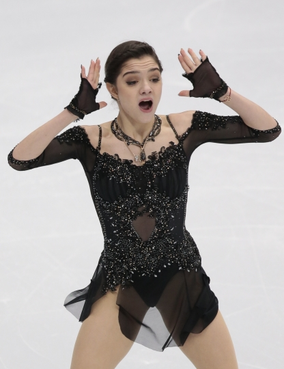 FILE - In this Saturday, Oct. 21, 2017 file photo, Evgenia Medvedeva of Russia skates her free program at the Rostelekom Cup ISU Grand Prix figure skating event in Moscow, Russia. Two-time defending world figure skating champion Evgenia Medvedeva will address the International Olympic Committee board on Tuesday Dec. 5, 2017 ahead of a vote on whether to ban Russia from the upcoming Pyeongchang Games. (AP Photo/Ivan Sekretarev, file)