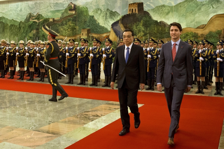 Canadian Prime Minister Justin Trudeau, right, walks with Chinese Premier Li Keqiang during a welcome ceremony held at the Great Hall of the People in Beijing, China, Monday, Dec. 4, 2017. (AP Photo/Ng Han Guan)