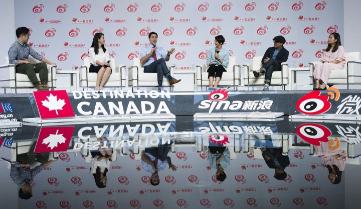 Canadian Prime Minister Justin Trudeau takes part in an event at Sina Weibo headquarters in Beijing, China, Monday, Dec. 4, 2017, to promote Canada-China tourism. Trudeau was joined by young professional Chinese who have visited Canada, in order to share their experiences. (Sean Kilpatrick/The Canadian Press via AP)