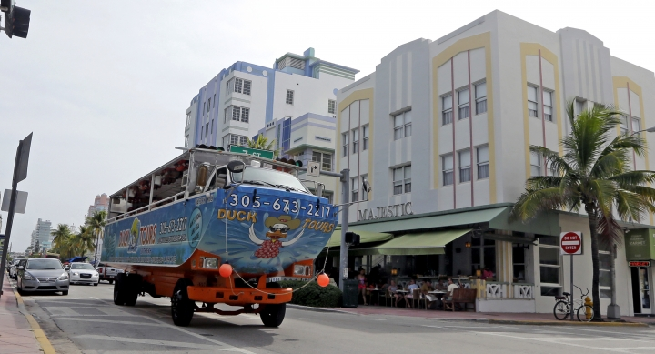 FILE - In this Sept. 1, 2016, file photo, a tourist bus drives by Ocean Drive in the South Beach area of Miami Beach, Fla. South Beach can be a great place for parents and teens to vacation together, especially if they can go their separate ways at times for beach, pool, shopping and dining. (AP Photo/Alan Diaz, File)