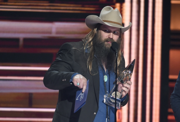 "FILE - In a Wednesday, Nov. 8, 2017 file photo, Chris Stapleton accepts the award for album of the year ""From A Room: Volume 1"" at the 51st annual CMA Awards at the Bridgestone Arena, in Nashville, Tenn. (Photo by Chris Pizzello/Invision/AP)"