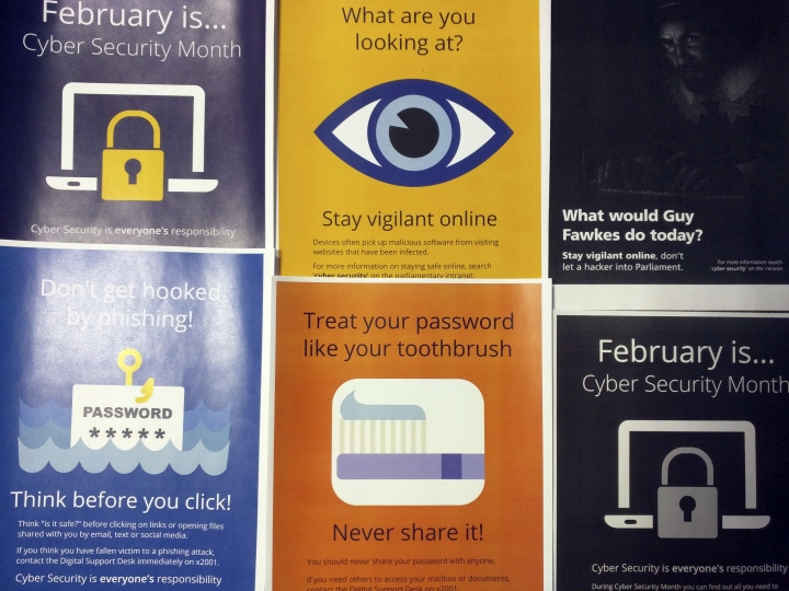 Cybersecurity awareness posters obtained through a Freedom of Information are pictured in Paris, Monday, Dec. 4, 2017. British lawmakers are flouting explicit instructions to lock their computers and not to share their passwords, documents obtained by The Associated Press show, a revelation that raises questions about the security of Britain's parliamentary network only months after a well-publicized email break-in. (AP photo/Raphael Satter)