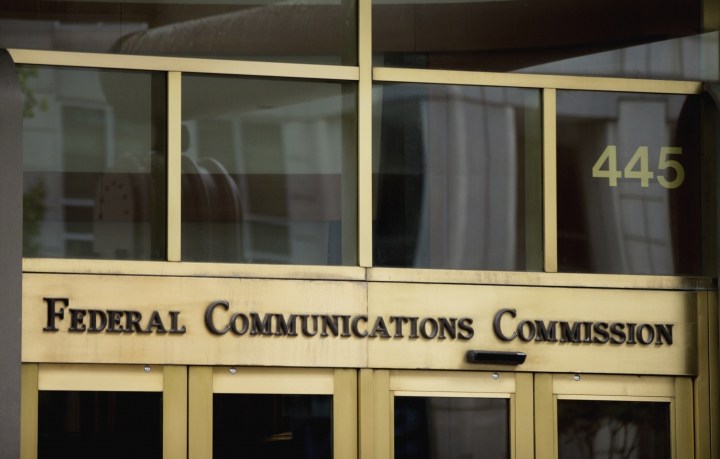 """FILE - This June 19, 2015, file photo, shows the entrance to the Federal Communications Commission (FCC) building in Washington. In its push to undo Obama-era """"net neutrality"""" rules, the country's Republican-led telecom regulator has defended its proposal with some statements that are incomplete or misleading. But a Democratic official in favor of net neutrality also criticized the Federal Communications Commission Chairman, Ajit Pai, in a way that left out crucial context. (AP Photo/Andrew Harnik, File)"""