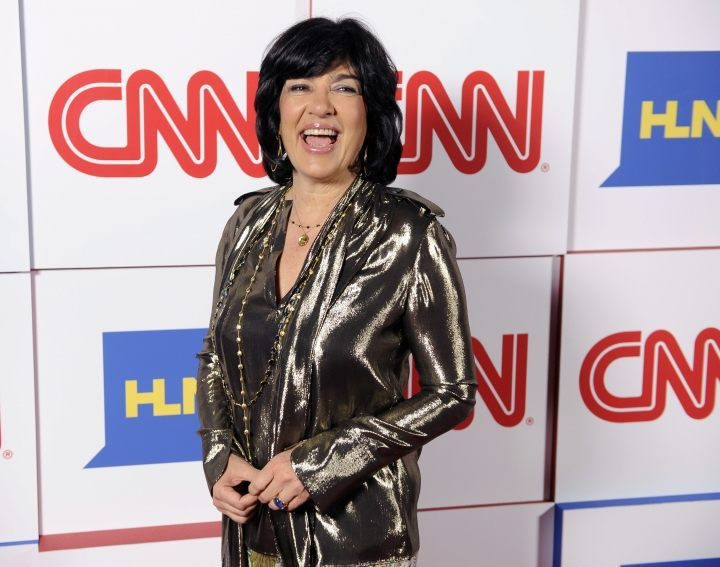 FILE - In this Jan. 10, 2014, file photo, Christiane Amanpour of CNN reacts to photographers at the CNN Worldwide All-Star Party in Pasadena, Calif. Amanpour is helping PBS fill the gap created by Charlie Rose's exit. On an interim basis, public TV stations will be able to air Amanpour's weekday public affairs program that originates on CNN International. (Photo by Chris Pizzello/Invision/AP, File)