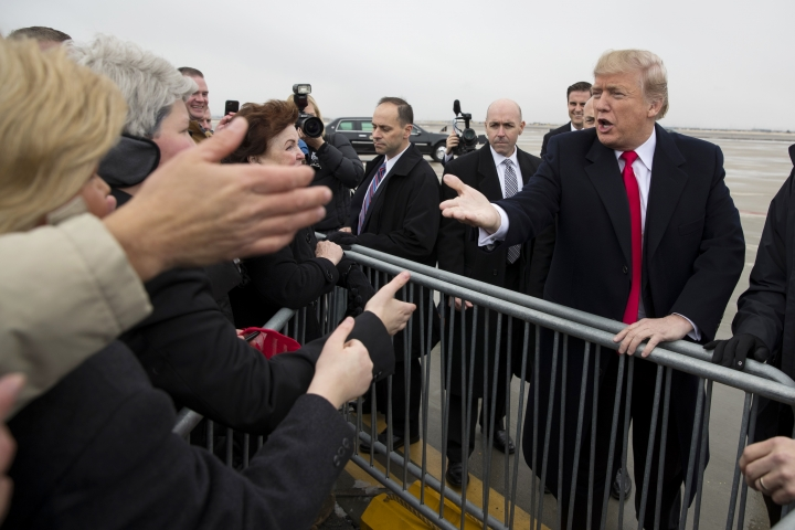 President Donald Trump shakes hands after arriving at Salt Lake City International Airport, Monday, Dec. 4, 2017, in Salt Lake City. (AP Photo/Evan Vucci)