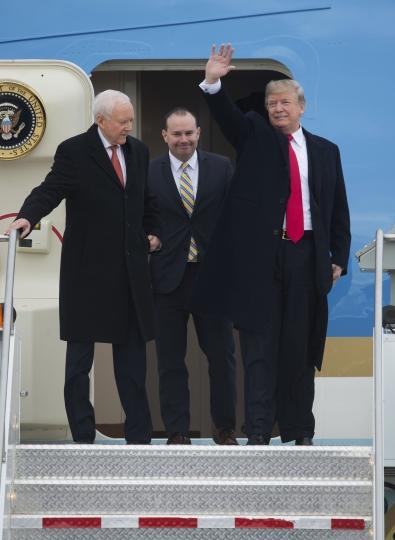 President Donald Trump stands with Sen. Orrin Hatch, R-Utah, left, and Sen. Mike Lee, R-Utah, center, after arriving at the Ronald R Wright National Air Guard Base in Salt Lake City on Monday, Dec. 4, 2017. (Scott Sommerdorf/The Salt Lake Tribune via AP)