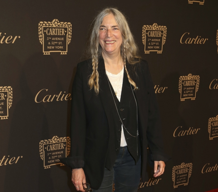 FILE - In this Sept. 7, 2016 file photo, Patti Smith attends the Cartier Fifth Avenue Mansion grand reopening celebration in New York. Smith and Salman Rushdie have compared notes on everything from the writing process to how they cope in the age of President Donald Trump. (Photo by Greg Allen/Invision/AP, File)
