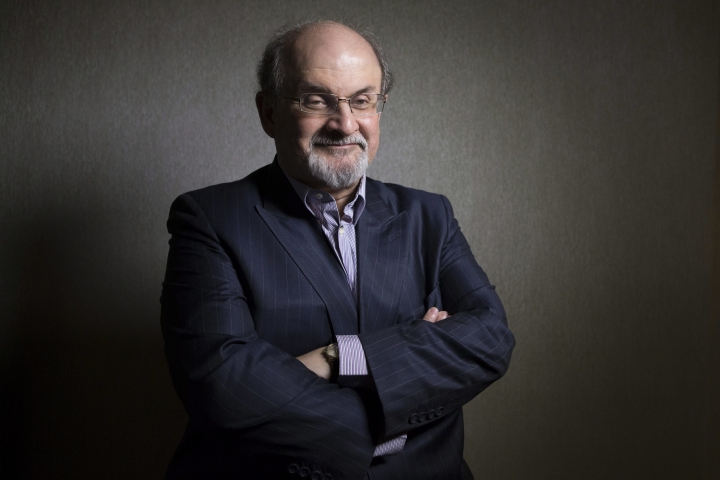 """FILE - In this Sept. 8, 2012, file photo, author Salman Rushdie poses for a photo as he promotes the movie """"Midnight's Children"""" during the 2012 Toronto International Film Festival in Toronto. Rushdie and Patti Smith have compared notes on everything from the writing process to how they cope in the age of President Donald Trump. (Chris Young/The Canadian Press via AP, File)"""