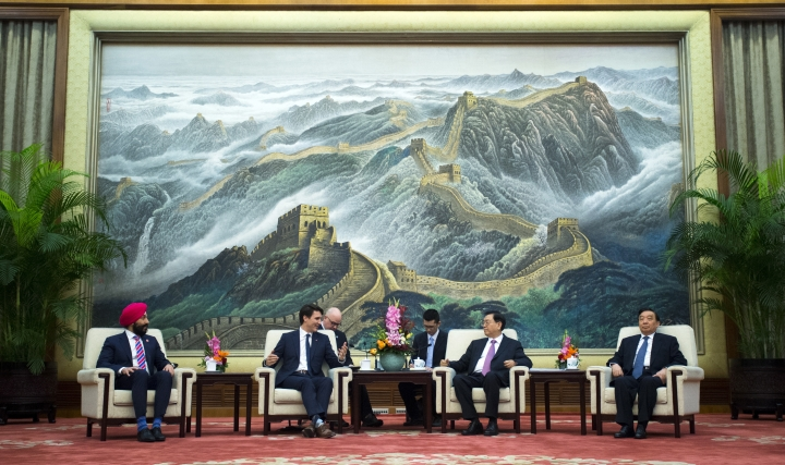 Canadian Prime Minister Justin Trudeau, second from left, talks with Chairman of the Standing Committee of the National People's Congress Zhang Dejiang, second from right, during a meeting at the Great Hall of the People in Beijing Tuesday, Dec. 5, 2017. (Sean Kilpatrick/The Canadian Press via AP)