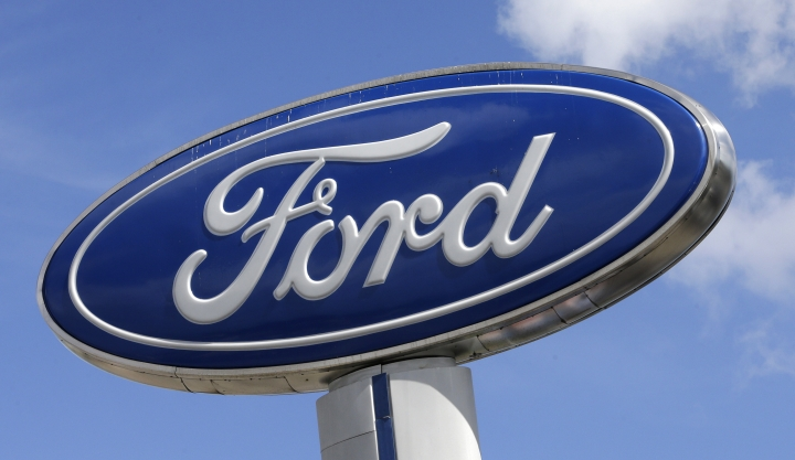 FILE - This Jan. 17, 2017, file photo shows a Ford sign at an auto dealership, in Hialeah, Fla. At least 30 percent of the new vehicles Ford will roll out in China by 2025 will be electric, with Beijing pushing hard to improve air quality for people living in smoke-choked cities. Ford said Tuesday, Dec. 5, that the new electric cars will fall under the Lincoln brand and its namesake. (AP Photo/Alan Diaz, File)