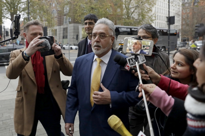 F1 Force India team boss Vijay Mallya arrives for the second day of his extradition case at Westminster Magistrates Court in London, Tuesday, Dec. 5, 2017. Indian tycoon Vijay Mallya is set to faces an extradition hearing in London that should determine whether he is sent back to India to face money laundering allegations related to the collapse of several of his businesses. (AP Photo/Matt Dunham)
