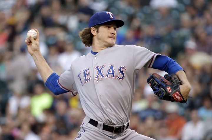 FILE - In this Aug. 25, 2014, file photo, Texas Rangers starting pitcher Miles Mikolas throws against the Seattle Mariners in the first inning of a baseball game Monday, Aug. 25, 2014, in Seattle. Right-hander Miles Mikolas is returning from Japan, agreeing to a $15.5 million, two-year contract with the St. Louis Cardinals. The 29-year-old's agreement was announced Tuesday, Dec. 5, 2017. (AP Photo/Elaine Thompson, File)