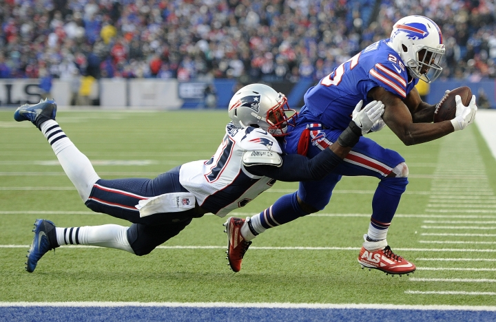 Buffalo Bills running back LeSean McCoy, right, runs with the ball as New England Patriots strong safety Jordan Richards (37) makes a tackle during the second half of an NFL football game, Sunday, Dec. 3, 2017, in Orchard Park, N.Y. (AP Photo/Adrian Kraus)
