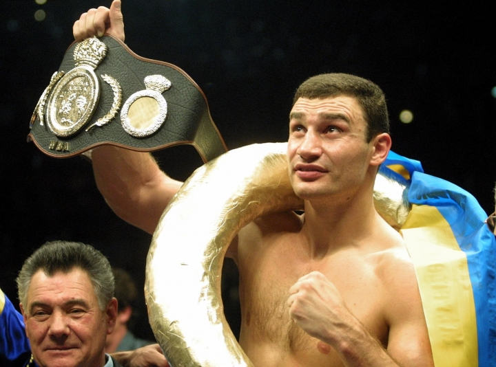 FILE - In this Jan. 28, 2001, file photo, Vitali Klitschko, of Ukraine, shows the world championship belt. after he knocked out Orlin Norris, of the United States, in the first round of a WBO heavyweight title fight in Munich, Germany. Former heavyweight champion Vitali Klitschko, four-division world champion Erik Morales, and light middleweight champion Ronald Wright have been elected to the International Boxing Hall of Fame on Tuesday, Dec. 5, 2017. The Induction ceremony is June 10, 2018, in Canastota, N.Y. (AP Photo/Camay Sungu, File)