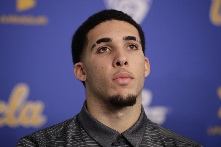"""FILe -In this Wednesday, Nov. 15, 2017, file photo, UCLA NCAA college basketball player LiAngelo Ball attends a news conference at UCLA in Los Angeles. The father of UCLA guard LiAngelo Ball says he's withdrawing his son from school so he can prepare to play in the NBA. LaVar Ball says his """"grand plan"""" is for all three sons to play for the Los Angeles Lakers. LiAngelo told """"Access Hollywood"""" in an interview aired Tuesday, Dec. 5, 2017, on the """"Today"""" show that his UCLA suspension is """"just a long time of doing nothing. I'd rather be playing.""""(AP Photo/Jae C. Hong, File)"""