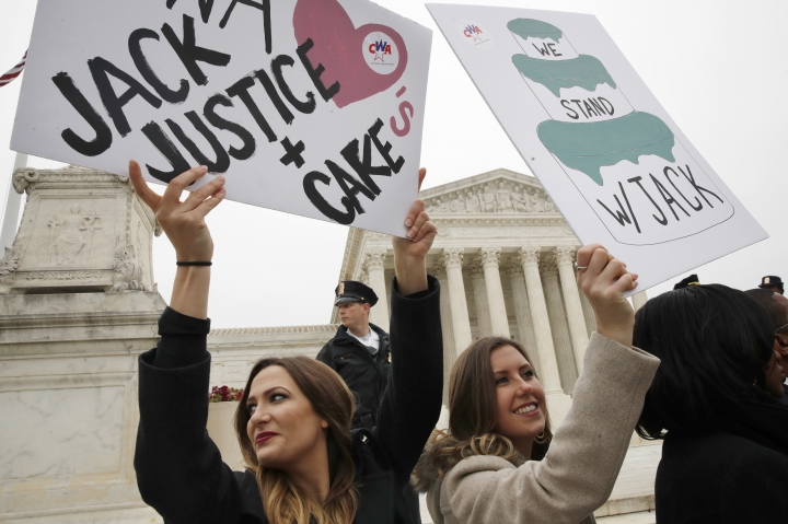 Janae Stracke, left, and Annabelle Rutledge, both with Concerned Women for America, hold up signs in support of cake artist Jack Phillips outside of the Supreme Court which is hearing the 'Masterpiece Cakeshop v. Colorado Civil Rights Commission,' Tuesday, Dec. 5, 2017, in Washington. (AP Photo/Jacquelyn Martin)