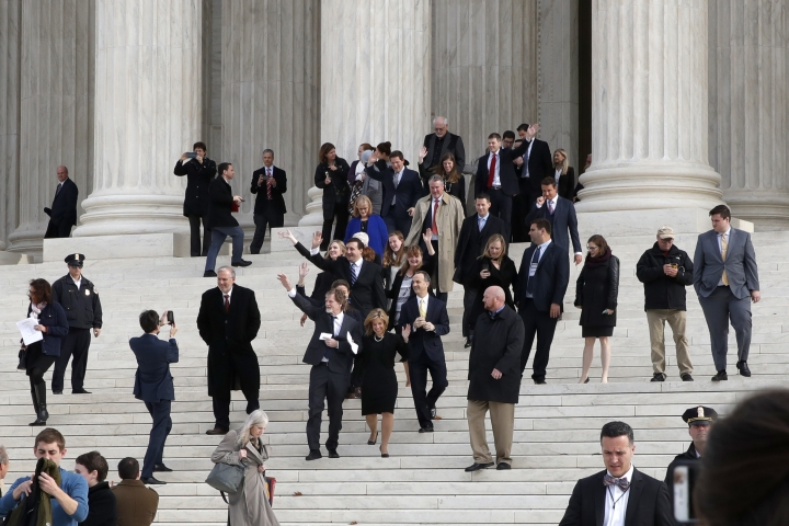 Jack Phillips, center left and next to attorney Kristen Waggoner, waves to supporters as they leave the Supreme Court 'Masterpiece Cakeshop v. Colorado Civil Rights Commission' case, Tuesday, Dec. 5, 2017, in Washington. (AP Photo/Jacquelyn Martin)