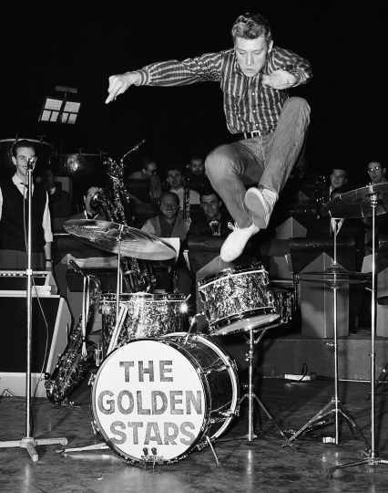 FILE - This Oct. 22 1962 shows French pop singer, Johnny Hallyday, leaps into the air whilst rehearsing at the Olympia Theater in Paris. The French president's office says Hallyday, who packed sports stadiums for decades, has died at age 74. (AP Photo/Jean Jacques Levy, File)