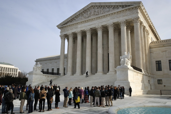 People stand in line to enter the Supreme Court where a case on sports betting is being heard, Monday, Dec. 4, 2017, in Washington. (AP Photo/Jacquelyn Martin)