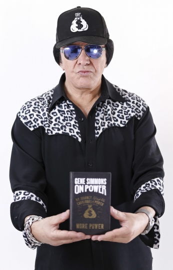 "In this Nov. 14, 2017 photo, Kiss frontman Gene Simmons poses for a portrait in New York to promote his book, ""On Power."" (Photo by Brian Ach/Invision/AP)"